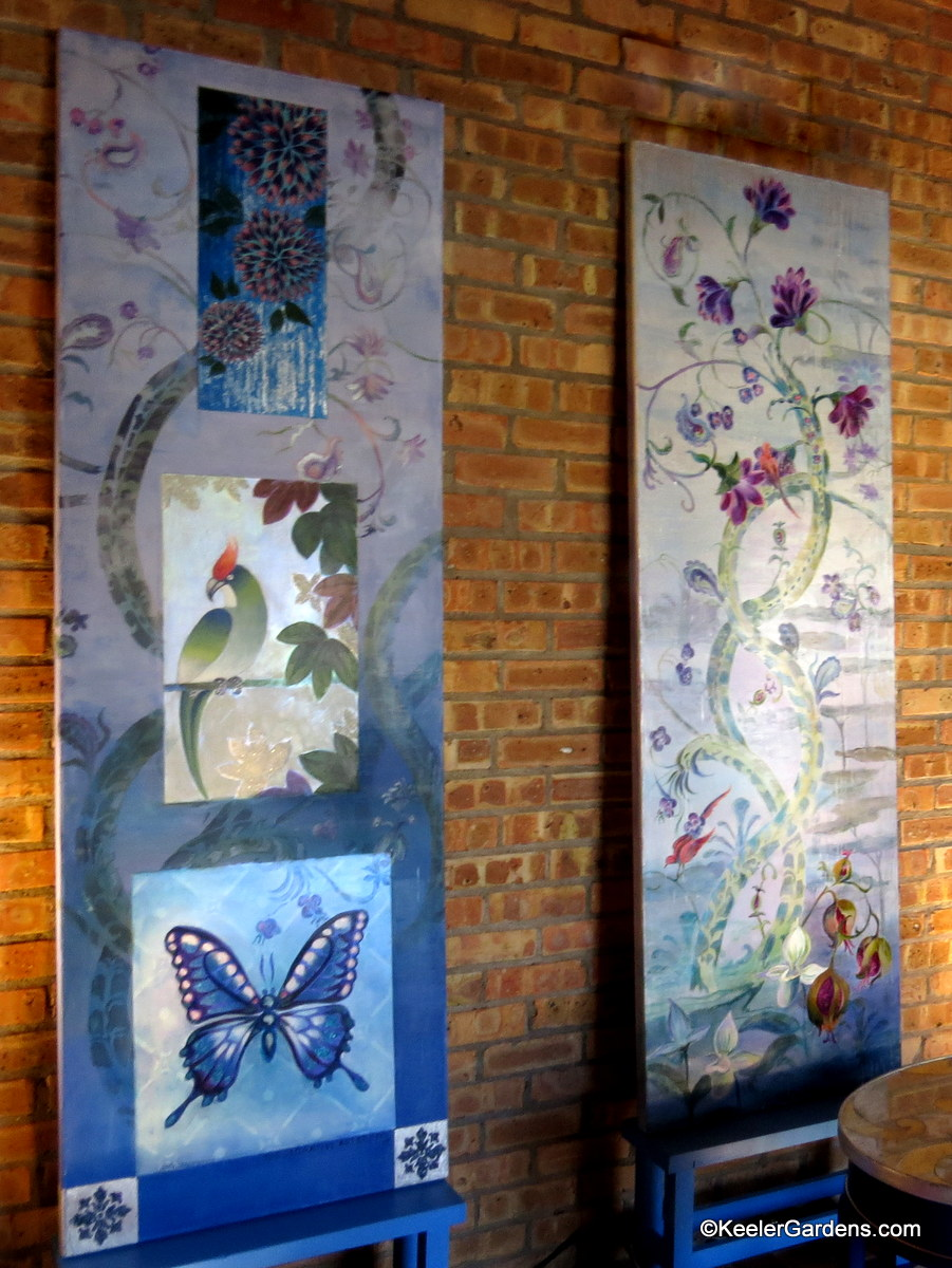 Two Tall Canvas Paintings By Meg Fine Art Sit Side At An